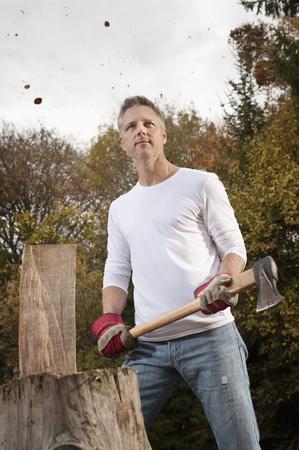 non urban 1: Man chopping wood