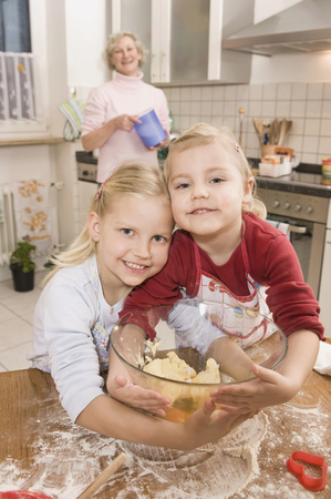 cutter: Family preparing cookies in kitchen, smiling