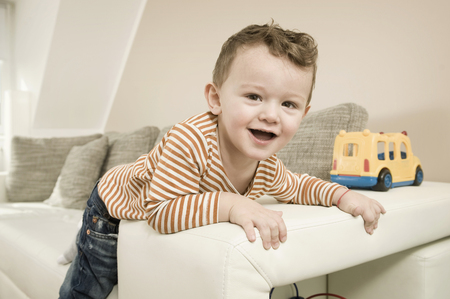 twee: Portrait of boy playing with toys, smiling LANG_EVOIMAGES