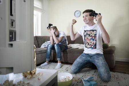 Two teenage boys playing video game