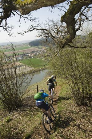 Young men mountainbiking, Bavaria, Germany