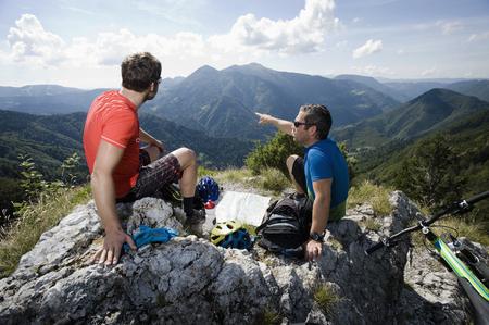 mtb: two mountain biker having a rest, Slatnik, Istria, Slovenia