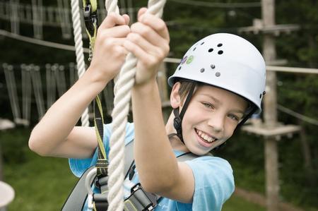 Portrait of boy climbing crag, smiling LANG_EVOIMAGES