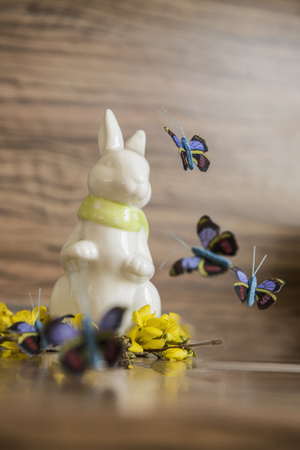 public celebratory event: Close-up of Easter bunny with artificial butterflies