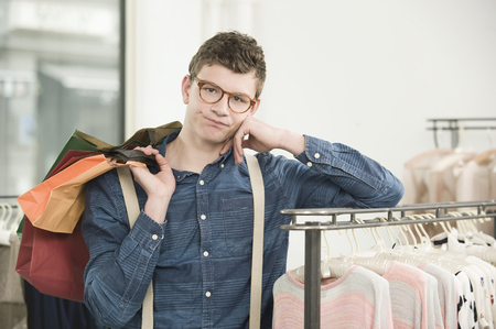 coathangers: Portrait of young man at fashion store