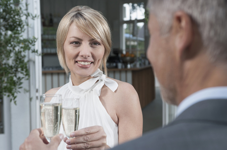 Couple toasting married chic party champagne