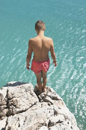 Waiting preparing teenager boy cliff diving
