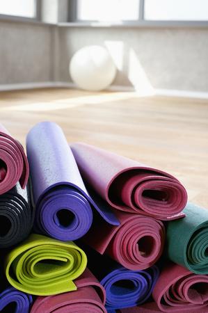 plainness: Close up Pile of colorful Yoga mats