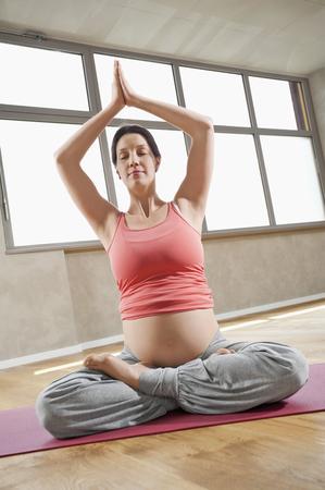 plainness: Pregnant woman Lotus position Yoga exercise LANG_EVOIMAGES