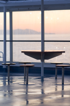 without windows: Boat ferry cruise ship deck sunrise table chairs LANG_EVOIMAGES