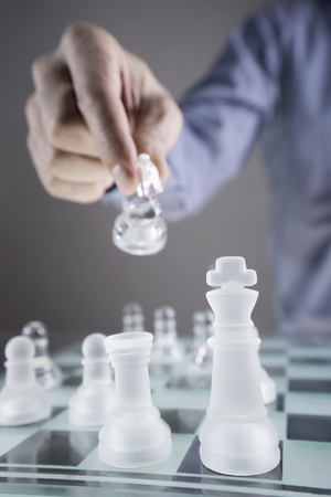 pawn adult: Close-up of mans hand going for checkmate while playing chess, Bavaria, Germany