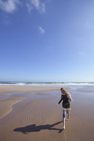lust for life: Girl running walking beach waves lunan bay summer LANG_EVOIMAGES