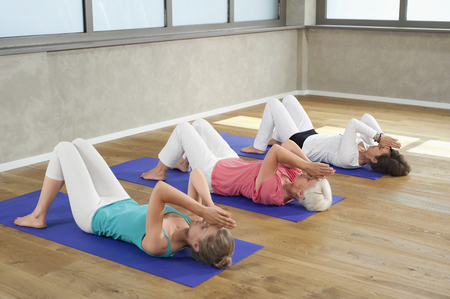 plainness: Three women fitness studio Meditation Yoga LANG_EVOIMAGES
