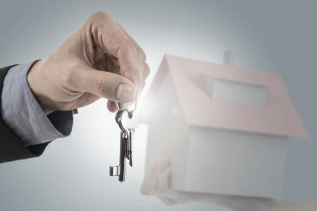 Close-up of a businessmans hand holding house keys, Bavaria, Germany LANG_EVOIMAGES