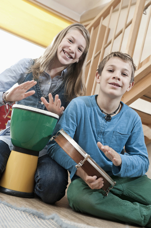 drumming: Portrait of two drumming children LANG_EVOIMAGES