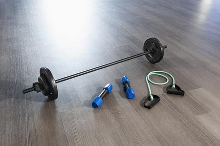plainness: Fitness training room wooden floor barbell