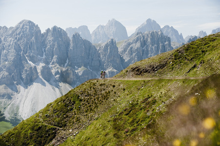 faraway: Two Mountainbikers racing down mountain track