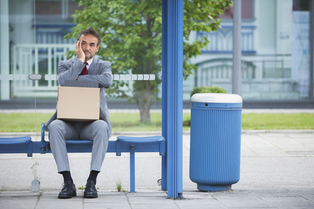dept: Man Alone anxiety bad luck news bankrupt business LANG_EVOIMAGES