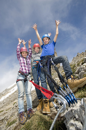 perilous: Three young teenagers mountain climbing