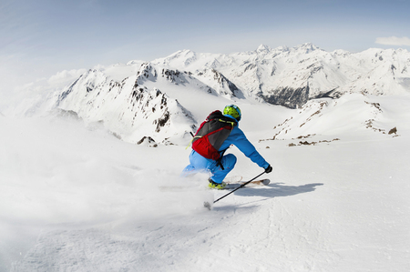 lust for life: Man skier skiing downhill steep slope mountains LANG_EVOIMAGES