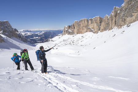 ski walking: Ski mountaineers climbing on snowy mountain, Val Gardena, Trentino-Alto Adige, Italy