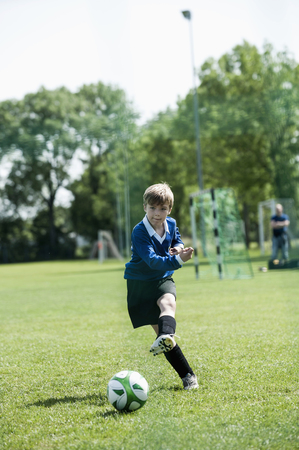 Young boy soccer penalty practice football ball LANG_EVOIMAGES