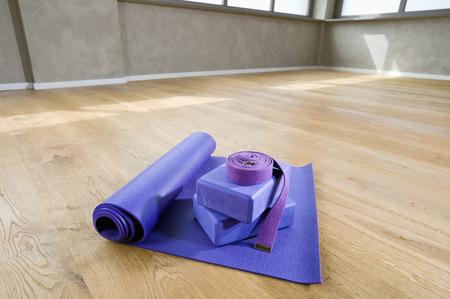 without windows: Blue Yoga matt belt still life yoga studio floor