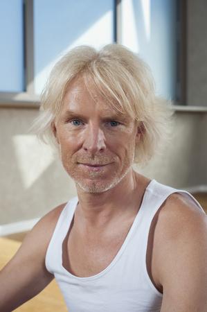 plainness: Portrait senior man in Yoga studio floor