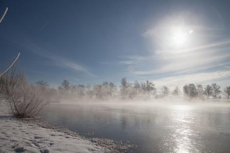 frozen lake: Sun shining over lake in winter, Eichenau, Fürstenfeldbruck, Bavaria, Germany