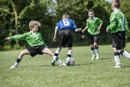strip shirt: Junior boys football soccer game sliding tackle
