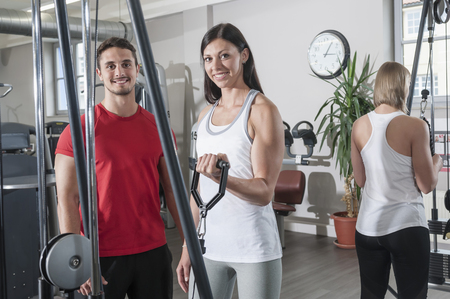lust for life: Fitness studio man two women sport healthy fit LANG_EVOIMAGES
