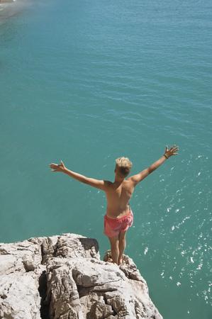Boy cliff diving holiday ocean sunshine summer