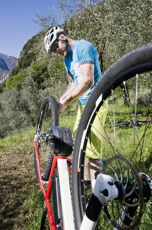 Man repairing flat type on electic-mountainbike