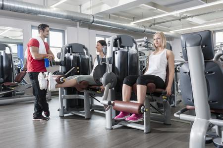 lust for life: Three people fitness studio man two women sport