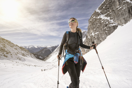 Young woman skiing, Bavaria, Germany LANG_EVOIMAGES