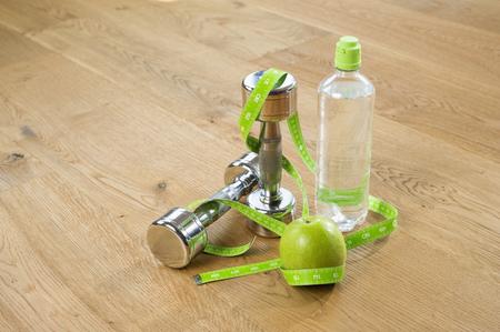 plainness: Close up apple barbells water bottle tape measure