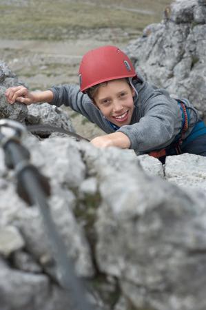 self conceit: Teenage boy helmet safety harness climbing