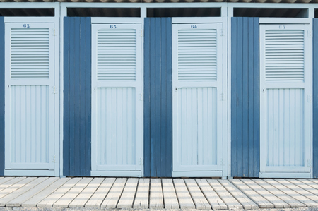 plainness: Row changing cubicle beach summer Italy blue