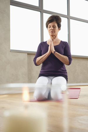 plainness: Mature woman Yoga exercise meditation