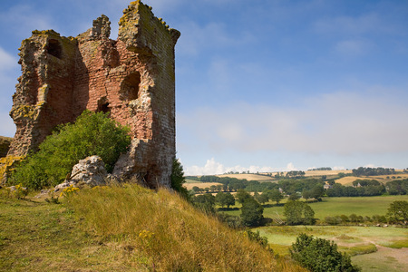 Red castle ruin Scotland Lunan bay landscape LANG_EVOIMAGES