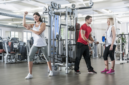 lust for life: Fitness trainer studio man two women sport fit
