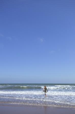 lust for life: Girl blue sky walking beach waves lunan bay summer LANG_EVOIMAGES
