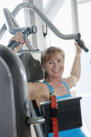 lust for life: Portrait mature woman fitness studio smiling happy