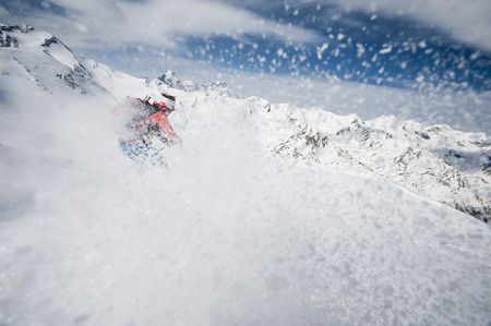 lust for life: Skier woman downhill powder snow Alps