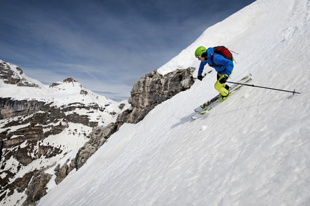 Man skiing downhill, Santa Cristina, Valgardena, Alto Adige, Italy LANG_EVOIMAGES