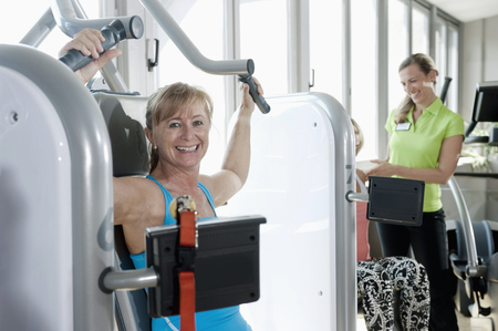 lust for life: Mature woman fitness trainer studio practicing LANG_EVOIMAGES