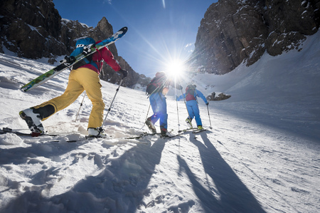 lighted: Men on a ski tour, Santa Cristina, Valgardena, Alto Adige, Italy