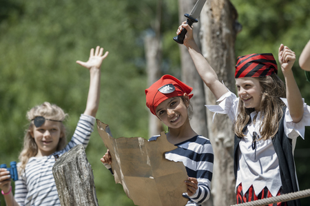 about age: Girls playing on pirate ship in adventure playground, Bavaria, Germany