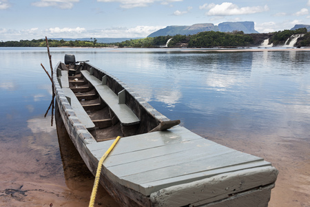 cascade: Typical Boat moored at Canaima Lagoon, Canaima National Park, Venezuela LANG_EVOIMAGES