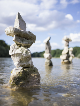 Close-up of stack of rocks balancing in Isar river, Bavaria, Germany